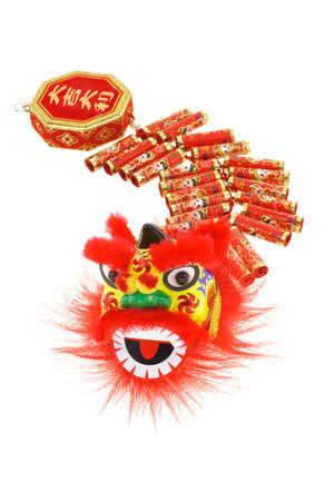 fire crackers: Chinese new year lion head and fire crackers ornaments arranged on white background
