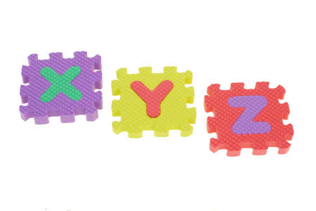 xyz: Colorful puzzle blocks with XYZ arranged on white background