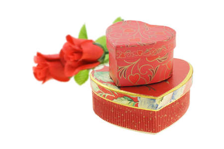 Heart shape floral gift boxes with roses on white background photo