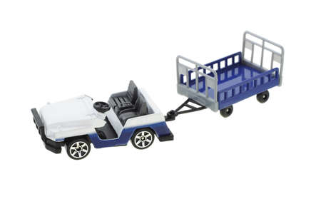 Toy airport baggage transporter and cart on white background photo