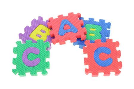 Colorful puzzle blocks arranged on white background Stock Photo - 9853584