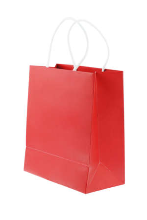 Red shopping bag on white background with copy space photo