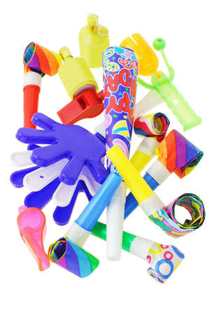 Assorted party noisemakers on white background photo