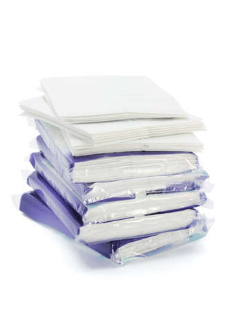 Stack of tissue packs on white background photo