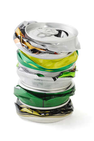 Stack of crushed aluminum cans on white background photo