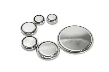 lithium: Lithium batteries of various sizes arranged on white background Stock Photo