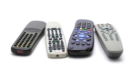 Assortment of wireless remote controllers arranged on white background photo