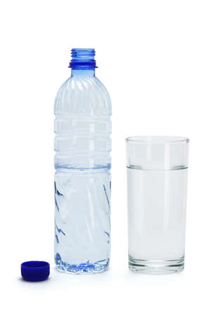 Mineral water in a glass and an open plastic bottle on white abckground photo