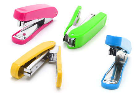 Four colorful staplers arranged on white background Stock Photo - 9853996