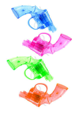 Multicolor plastic toy guns on white background photo