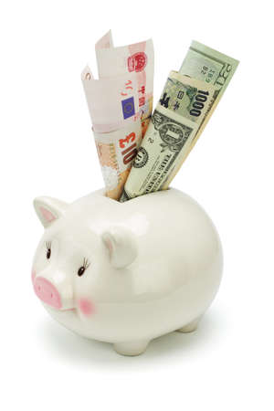 Piggy bank inserted with major world currency notes on white photo