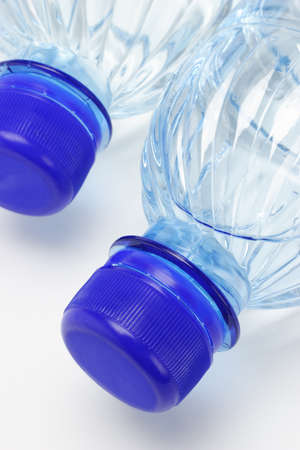 Close up of mineral water in plastic bottles photo