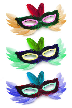 deceptive: Three colorful party face masks arranged on white background