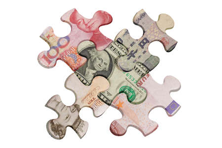 superimposed: Jigsaw puzzles superimposed with world major currencies
