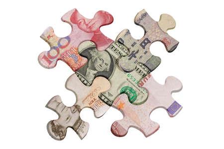 Jigsaw puzzles superimposed with world major currencies Zdjęcie Seryjne - 9854197