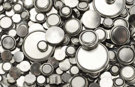batteries: Background image of lithium batteries of various sizes  Stock Photo