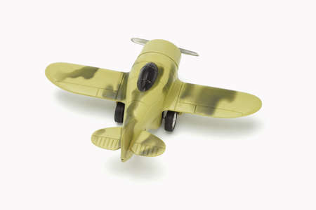 Toy military aircraft with camouflage paint on white background photo