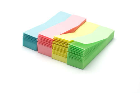 stacks of colorful narrow sticky packs on white photo