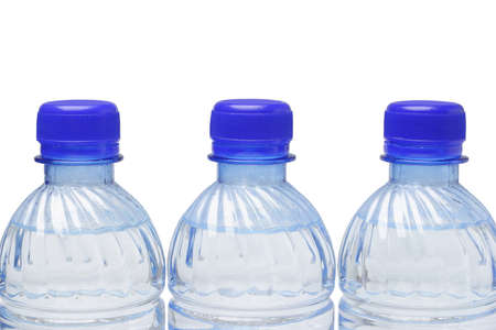 Mineral water in plastic bottles on white background with copy space photo