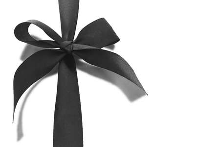 Black bow ribbon with reflection on white background photo