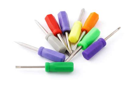 Multicolor mini screw drivers on white background photo