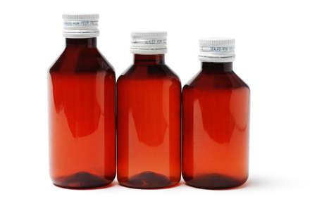 Three sealed medicine bottles on white background photo