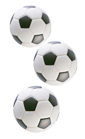 chequer: Three black and white soccer balls on white background