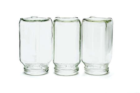 unlabelled: Three glass bottles inverted on white background