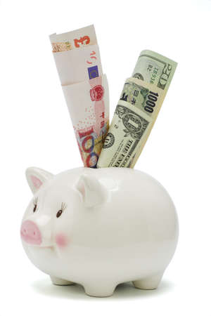 Piggy bank inserted with major world currency notes on white background   photo
