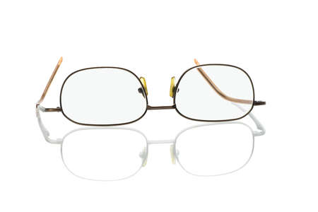 wearing spectacles: reading glasses inverted on white background with reflection Stock Photo