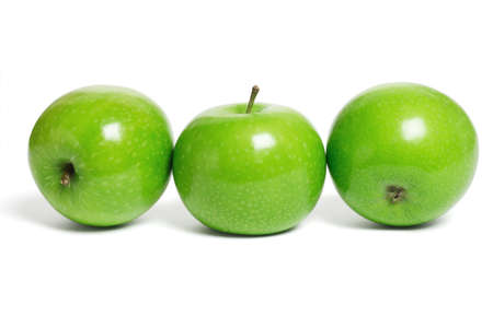 three objects: Three fresh green apples in a row on white background Stock Photo