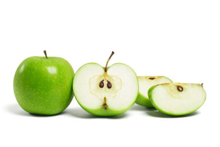 Whole fresh green apple and sliced pieces on white background photo