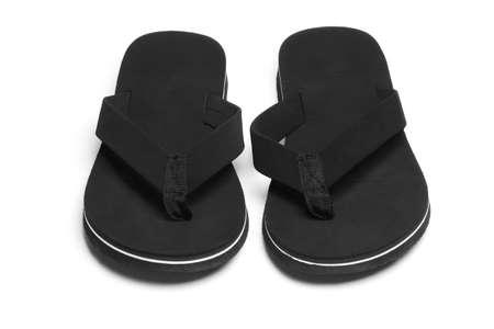 Pair of black flip flops casual footwear on white background Stock Photo - 10022614
