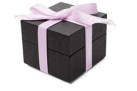 Black gift box with pink bow ribbon on white background photo