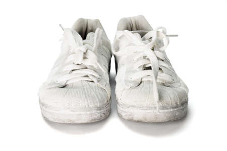 old worn out school canvas shoes on white background photo