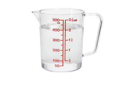 Plastic kitchen measuring cup filled with 400 cc of water on white background photo