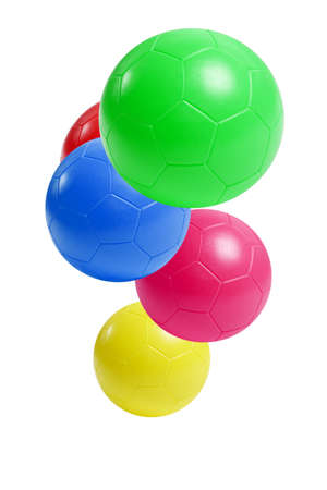 Colorful plastic soccer balls suspended in the air on white background photo
