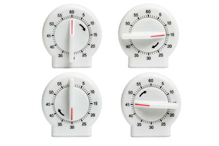 timekeeper: Collection of Kitchen timers showing dial setting at different times on white background