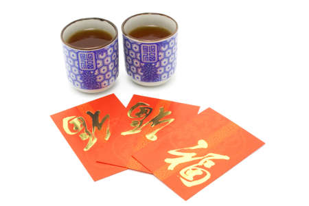 Chinese  prosperity tea cups and red packets for tea ceremony on white background photo
