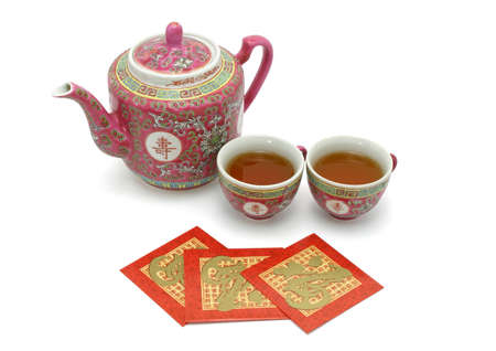 Chinese longevity tea set and red packets for tea ceremony on white background photo