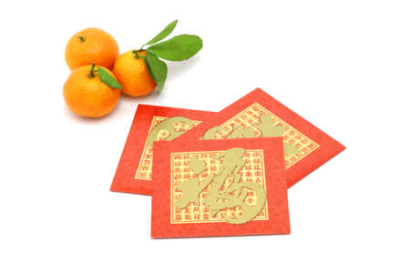 envelop: Chinese New Year mandarin oranges and red packets on white background