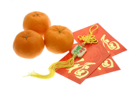 mandarin orange: Chinese New Year ornament, oranges and red packets on white background
