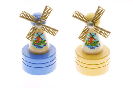 Miniature wooden windmills on white background Stock Photo - 10372459