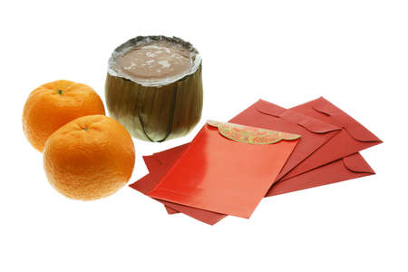 Chinese New Year cake, oranges and red packets on white background photo