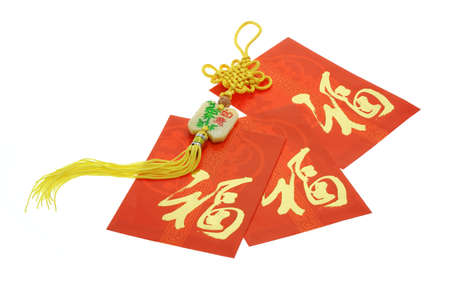 Chinese New Year red packets and ornament on white background