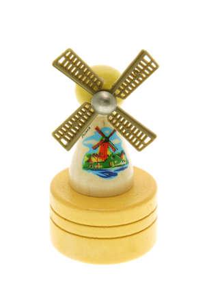 Miniature wooden windmill souvenir on white background Stock Photo - 10372367