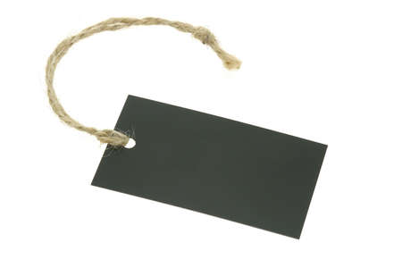Black blank paper label with raffia string on white background
