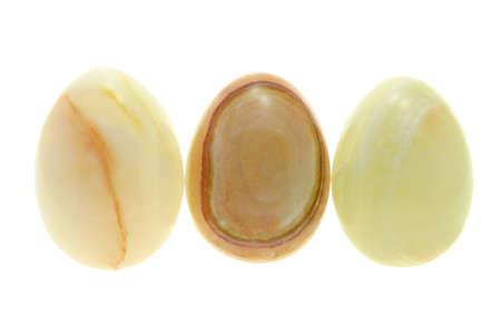 Three egg shaped semiprecious gemstones for Easter decoration photo