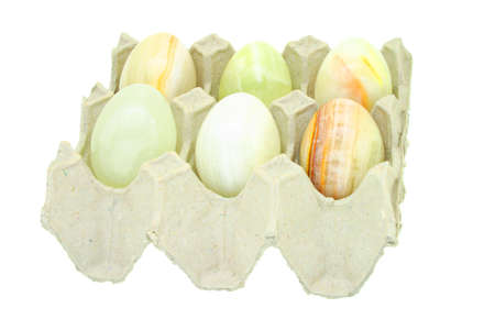 Egg shaped semiprecious gemstones placed in paper carton photo