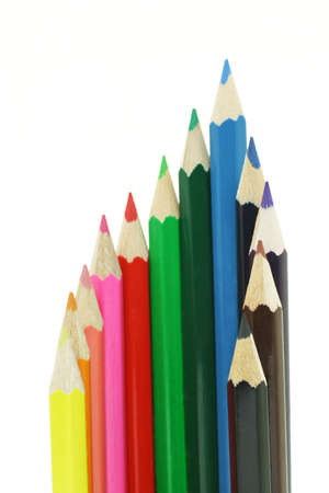 Color pencils in semi circle on white background photo